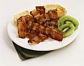 Fried Bacon Strips with Toast and Kiwi Slices