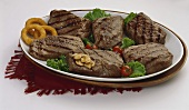 A Grilled Steak Platter with Mushrooms and Onion Rings