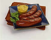 Grilled Hot Dogs with Mustard on Square Blue Plate