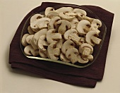 Sliced Button Mushrooms in a Shallow Bowl