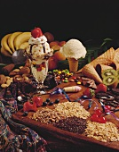 A Vanilla Ice Cream Cone and a Sundae Surrounded by Various Toppings