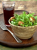 Bowl of Frisee Salad with Croutons, Glass of Ice Tea