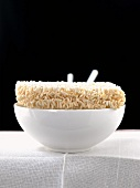 Dried Curly Noodles on a White Bowl