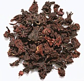 Pile of Dried Hibiscus on a White Background