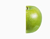 Half of a Granny Smith Apple on a White Background