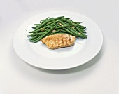 Plate with Almond Green Beans and a Chicken Breast; White Background