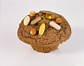 Bran Muffin Topped with Assorted Vitamins
