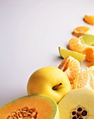 Assorted Fruit on a White Background; Melon, Apple and Peeled Citrus Wedges