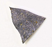 A Single Blue Corn Chip on a White Background