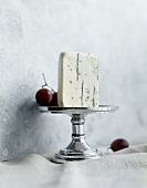 Blue Cheese on a Pedestal Dish with Red Grapes