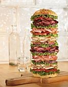 Tall Layered Sandwich Tower on a Cutting Board