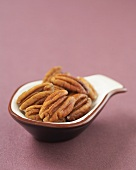 Whole Pecans in a Small Measuring Spoon