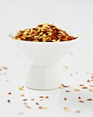 Chili Flakes in a Around a Small Bowl