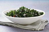 Kale with Bacon in a White Bowl