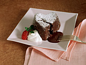 Heart-shaped chocolate pudding with chocolate sauce