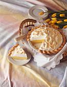 Lemon Meringue Pie, Slice Removed, with Yellow Tulips