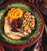Sliced Turkey with Stuffing Cranberries and Mashed Potatoes