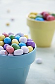 Candy Coated Chocolate Eggs in Colorful Flower Pots