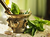Mortar and Pestle with Basil and Garlic