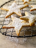Star Cookies Sprinkled with Powdered Sugar on a Cooling Rack