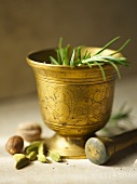Fresh Rosemary in an Ornate Mortar with Pestle and Spices