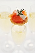 Salmon Blini on a Glass of Champagne