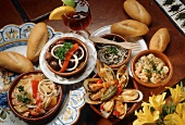 An Assortment of Tapas with Rolls