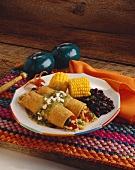 Plate of Chicken Enchiladas with Salsa Verde, Black Beans and Corn on the Cob