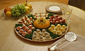 Hors d'oeuvres Platter, Fruit Tray, Plates and Glasses of Wine