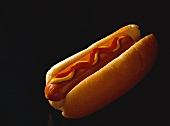 Hotdog on a Bun with Ketchup and Mustard, Black Background