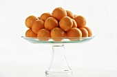 Clementines on a Clear Glass Pedestal Dish, White Background