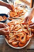 Hands Peeling Whole Boiled Shrimp