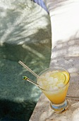 Rum and Fruit Juice Cocktail with Ice by the Pool