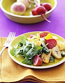 Roasted Vegetables and Arugula on a Yellow Plate