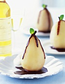 A Poached Pear in Chocolate Sauce with Mint Leaf