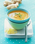 A Bowl of Carrot, Orange and Ginger Soup, Stacked Bowls
