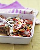 Scooping Vegetable Casserole with Tomatoes, Zucchini and Summer Squash