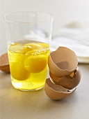 Cracked Eggs in a Glass with Egg Shells