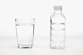 Glass of Water with a Bottle of Water, White Background