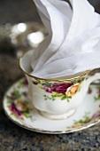 A Single Porcelain Tea Cup with Linen Napkin Set for High Tea