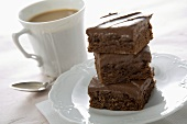 Stack of Brownies with a Cup of Coffee