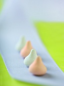 Row of Pastel Candy Covered Chocolates