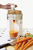 Hand Pressing Juicer to Make Carrot Juice, Fresh Carrots