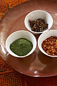 Three Small Bowls of Assorted Spices