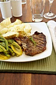 Grilled T-Bone Steak with Baked Potato, Asparagus and Yellow Squash