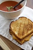 Whole Grilled Cheese Sandwich with a Bowl of Tomato Soup