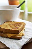 Whole Grilled Cheese Sandwich with a Bowl of Soup