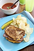 Grilled Ham and Cheese Sandwich with Chips and a Pickle, Bowl of Soup