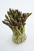 Bundle of Organic Asparagus on a White Background