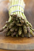 Close Up of the Tips of a Bundle of Organic Asparagus